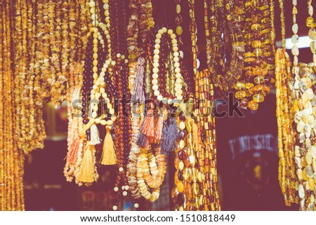 Amber pendants and necklaces at the street market of Curonian Spit, Kaliningrad region, Russia. #1510818449
