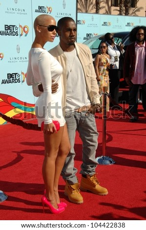 Amber Rose and Kanye West at the 2009 BET Awards. Shrine Auditorium, Los Angeles, CA. 06-28-09