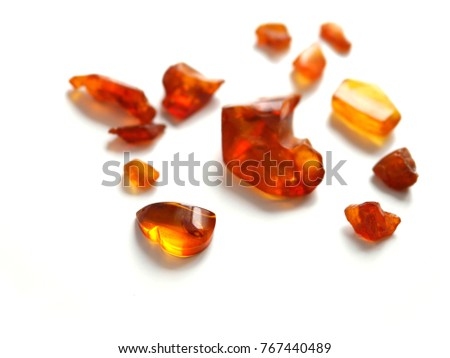 Amber stone isolated on white background.. Natural raw amber. Jewelery from amber. #767440489
