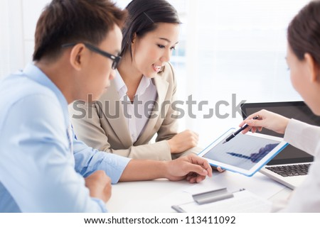 Ambitious business group being busy working on the project - stock photo