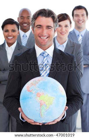 Ambitious business team showing a terrestrial globe against a white background