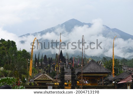Amblapura Bali - Indonesia, january 2010 Penjor and Lelontek adorn the view of Besakih Temple with Mount Agung in the background during the 2010 Piodalan celebration  Stockfoto ©