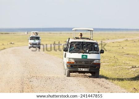 Amboseli, Kenya - February 4: Safari Cars with tourists in Amboseli National Park in Kenya on February 4, 2013