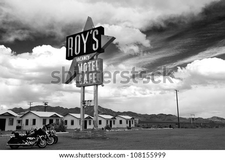 AMBOY, CA, USA - APRIL 8: Legendary Roy's Motel and Cafe in Amboy, CA on April 8, 2001. Roy's Motel and Cafe was a classic stop for gasoline or rest in the Mojave desert on historic Highway Route 66. - stock photo