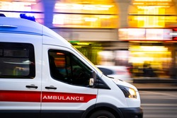 ambulance, blurred background, fast traffic