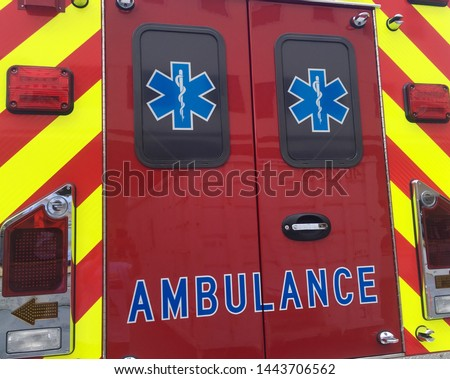 Ambulance Doors.  An emergency vehicle is parked momentarily. #1443706562