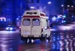 ambulance goes on the night rainy city