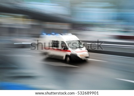 Ambulance in the city on a blurred background