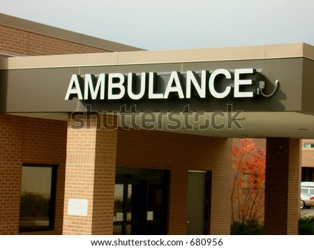 Ambulance in white letters on building. #680956