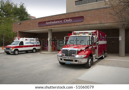 Ambulance pulling up to emergency entrance of a hospital