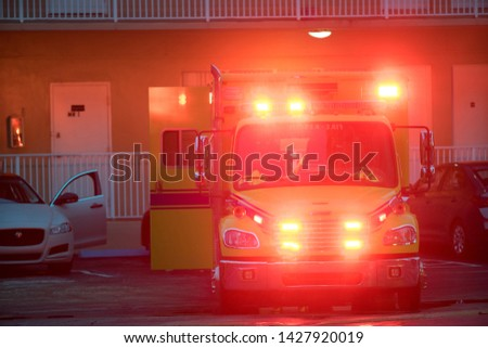 Ambulance responding to an accident scene with flashing lights #1427920019