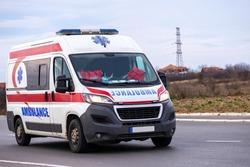Ambulance. Special medical vehicles. Ambulance van on road. Ambulance service van on street.