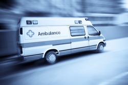 ambulance speeding with blurred motion