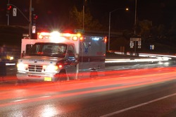 Ambulance standing in night traffic at a motor vehicle accident in early winter, Roseburg Oregon