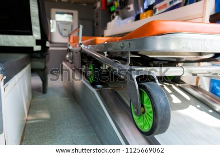 Ambulance stretcher and Life saving equipment  inside the ambulance, rescue concept. closeup view #1125669062