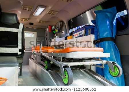 Ambulance stretcher and Life saving equipment  inside the ambulance, rescue concept. view from the back of vehicle. #1125680552