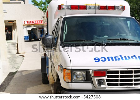 Ambulance vehicle in front of an emergency entrance to a hospital