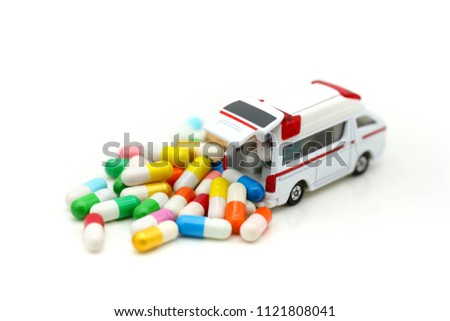 Ambulance with capsule drug,Medicine ambulance healthcare concept #1121808041