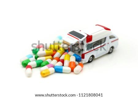 Ambulance with capsule drug,Medicine ambulance healthcare concept #1121808041