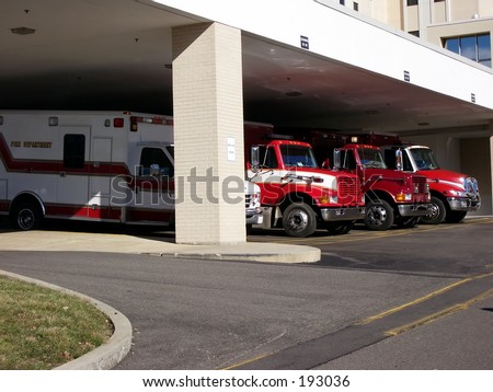 Ambulances lined up at a hospital emergency room.  Busy day in ER.