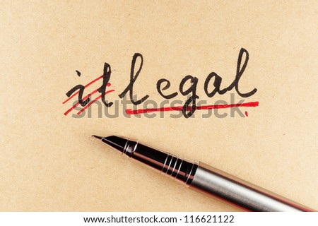 amending Illegal word and changing it  to legal using a pen