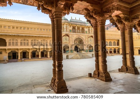 Amer Fort Jaipur Rajasthan main entrance gateway with intricate artwork and pillar structure.