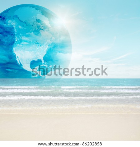 America globe on tropical beach. Map from NASA imagery