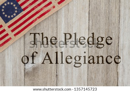 America patriotic message, USA patriotic old flag on a weathered wood background with text The Pledge of Allegiance #1357145723