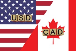 American and canadian currencies codes on national flags background. USD and CAD currencies