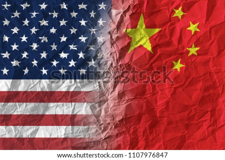 American and Chinese flags on crumpled paper, diplomatic crisis