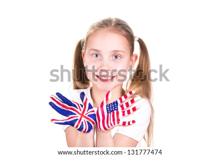 American and English flags on child's hands. Learning English language concept.
