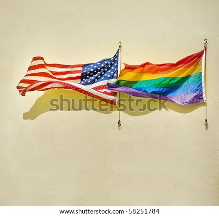 American and rainbow flags waving on a wall. Concept of equality and non discrimination