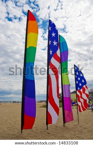 American and rainbow gay pride flags on the beach at Provincetown, Massachusetts, USA