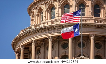 American and Texas state flags flying on the dome of the Texas State Capitol building in Austin ストックフォト ©