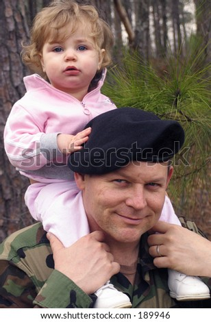 american army soldier with baby on his shoulders