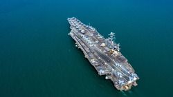 American battleship navy nuclear aircraft carrier, America military navy ship airplane carrier full loading plane fighter jet aircraft, Aerial view United States of America warship in open ocean.