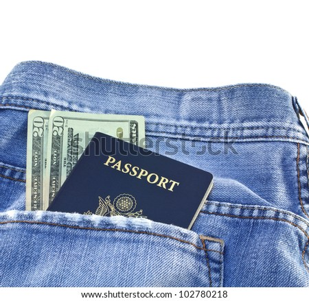 American blue passport and twenty dollar bills in light blue denim jeans pocket isolated on white background.