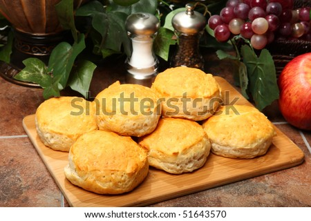 American breakfast biscuits stacked in kitchen on cutting board.