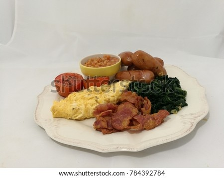 american breakfast with bake bean in white plate #784392784
