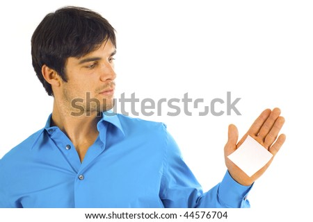 American businessman looking at his sticky note on the palm of his hand isolated over a white background