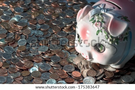 American coins and a piggy bank