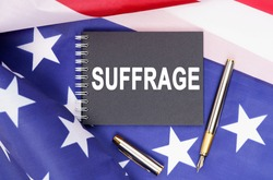 American concept. The US flag has a pen and a notebook with the inscription - SUFFRAGE