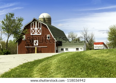 American countryside farm with barn and silo