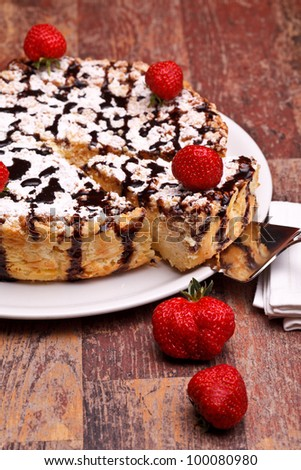 American Cuisine - Desserts - Cheescake with chocolate decorated with strawberries.
