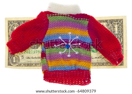 American Currency and Striped Winter Sweater Concept for Cost of Holiday Gift Shopping.
