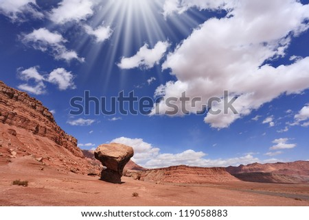 "American desert. The famous giant ""mushroom"" of red sandstone and the dazzling midday sun"