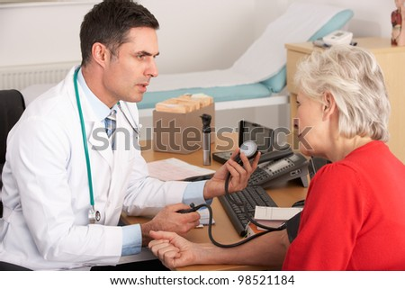 American doctor taking senior woman's blood pressure