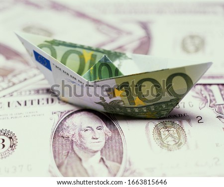 American 100 dollar bill shaped like a boat