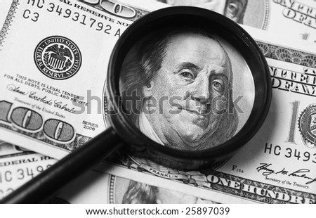 American dollar bill through a magnifying glass