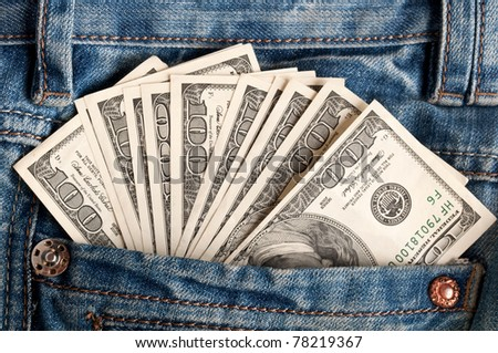 american dollar bills in jeans pocket background